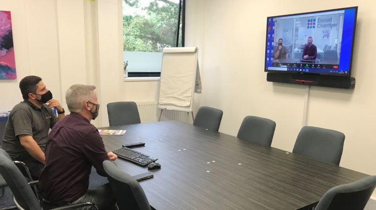 DCCI Boardroom upgrade with Yury Desiderio  (MD Walcom Integration Ltd) & Steve Bulley from the Dorset Chamber sitting in the Boardroom whilst testing the new upgrade.