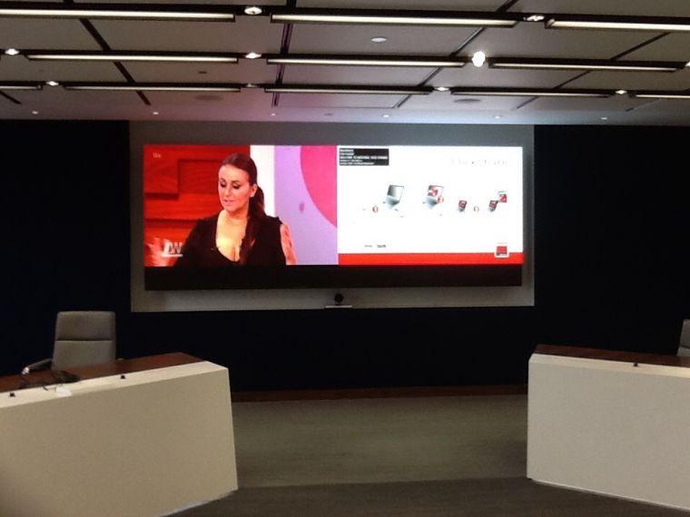 Large screen image set behind 2 presentation desks