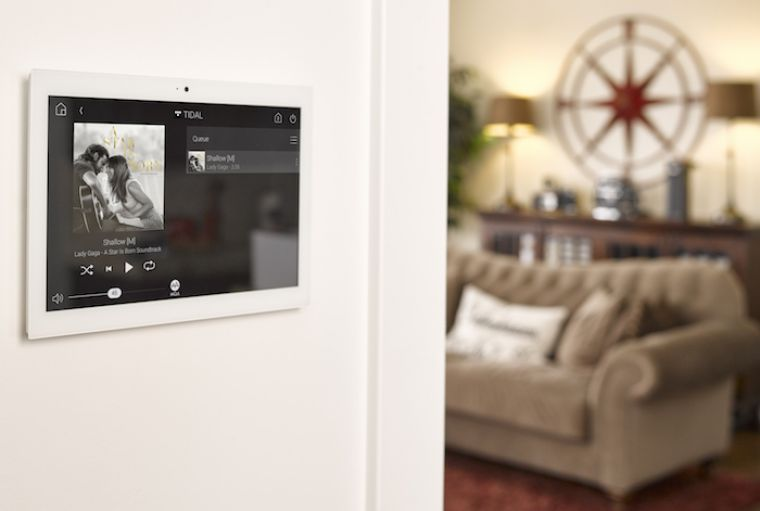 Wall mounted 'Computer Tablet controller with image of video that has been selected to play on the SMART Home TV or Cinema Room