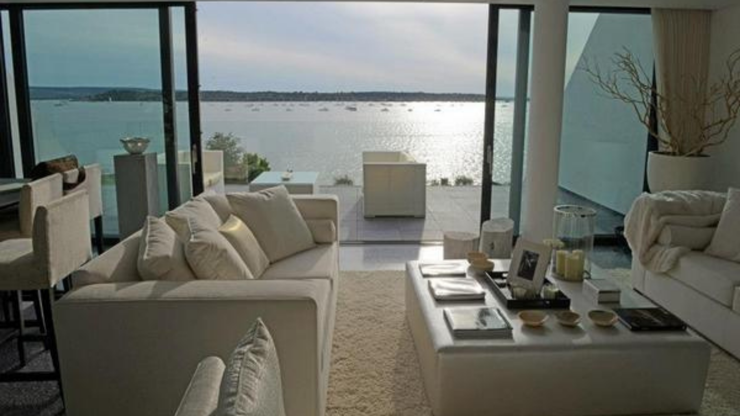 Sandbanks Road - Harbour Views from a lounge area with sliding doors opening onto a terrace