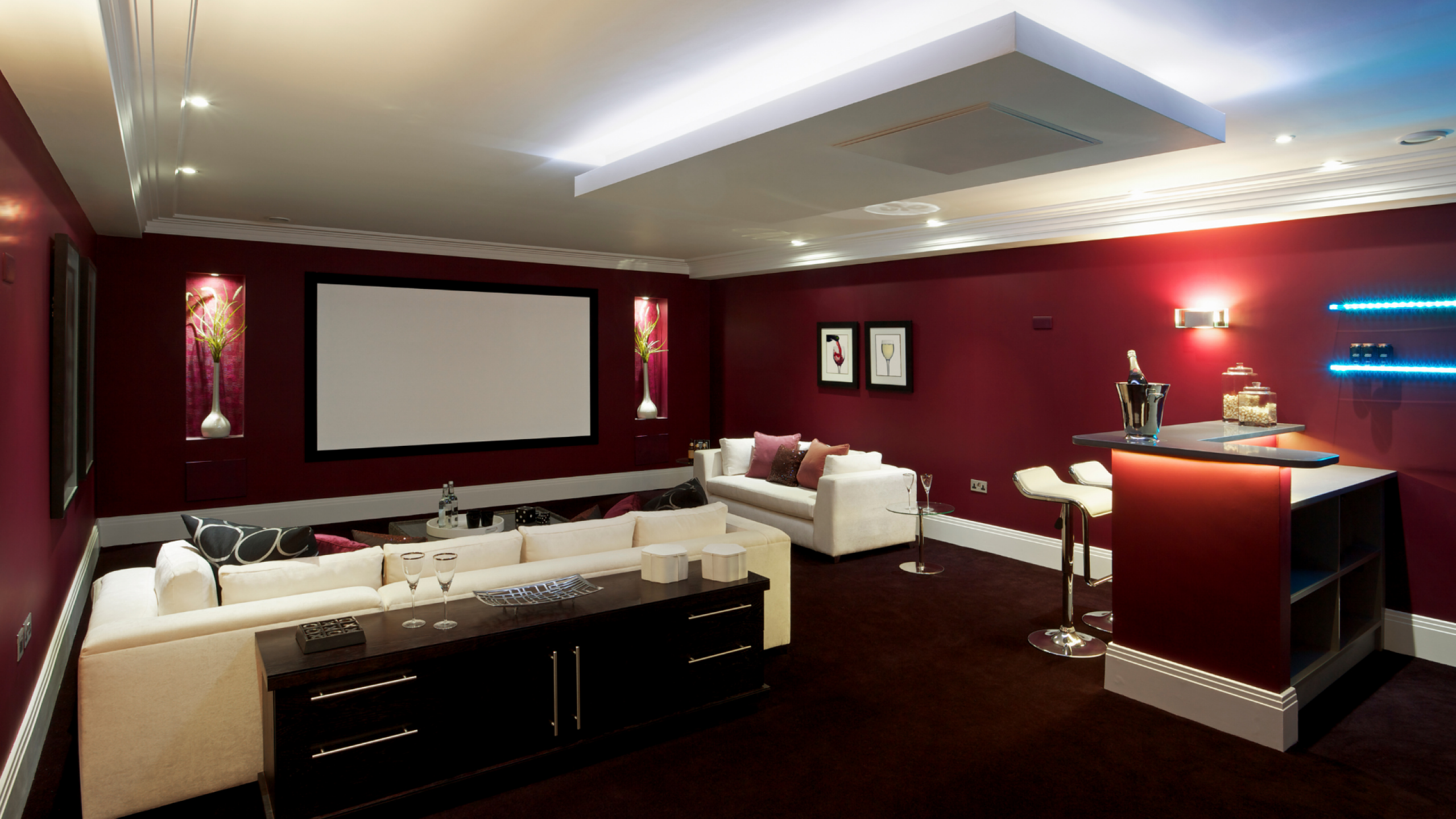 Cinema Room - Red walls with white furniture and small cocktail bar in corner