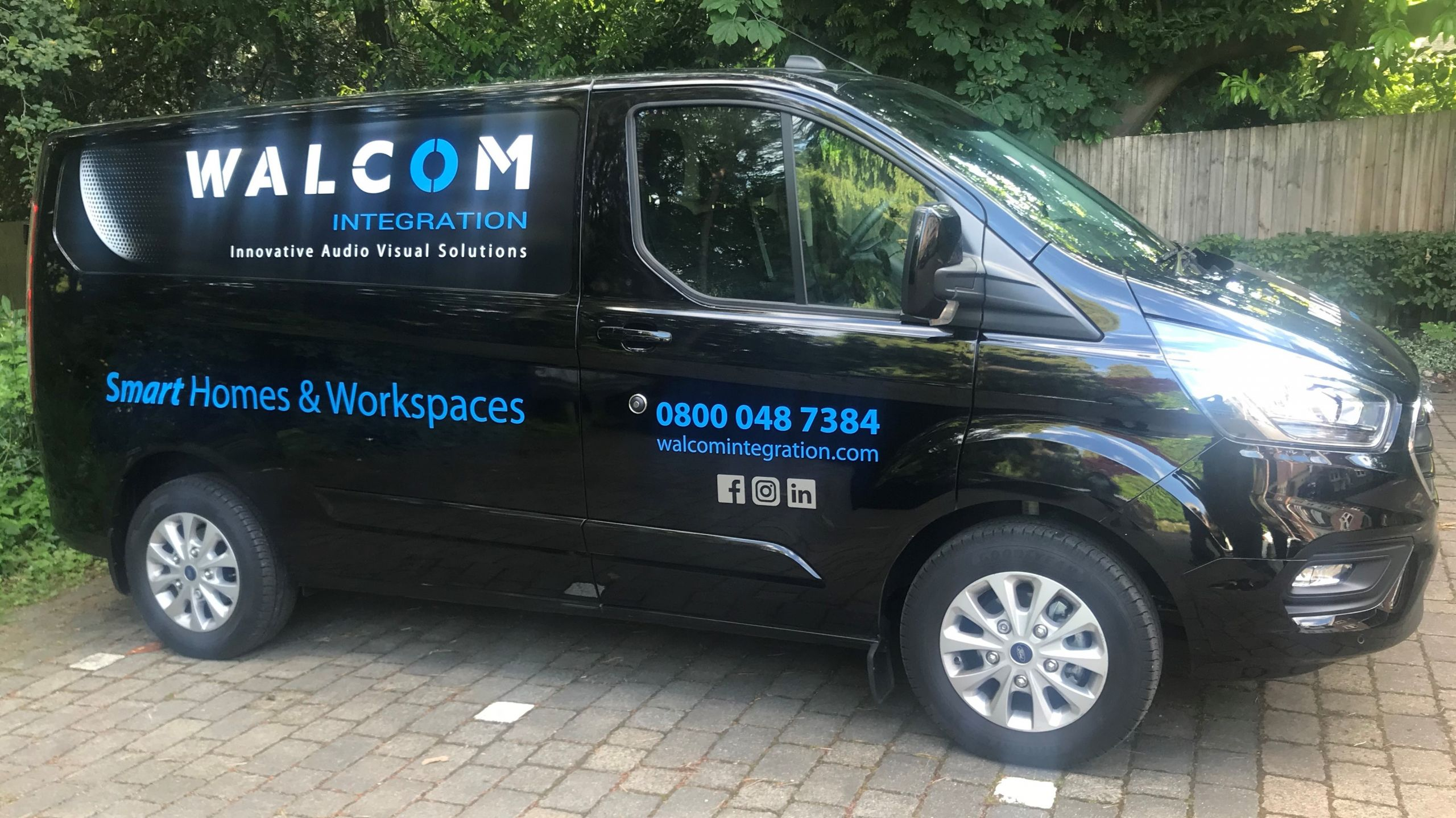 Side on view of van with Walcom Logo and details